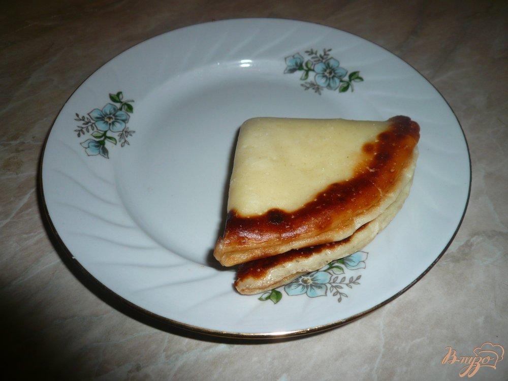 Фото приготовление рецепта: Кефирные блинчики с медом шаг №9