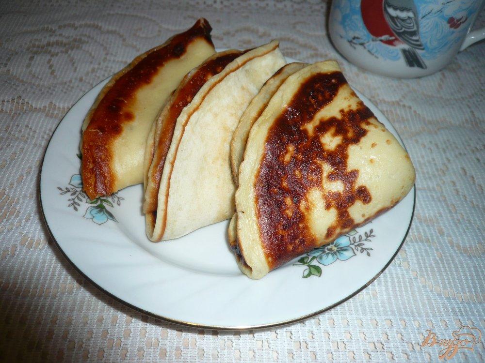 Фото приготовление рецепта: Кефирные блинчики с медом шаг №10