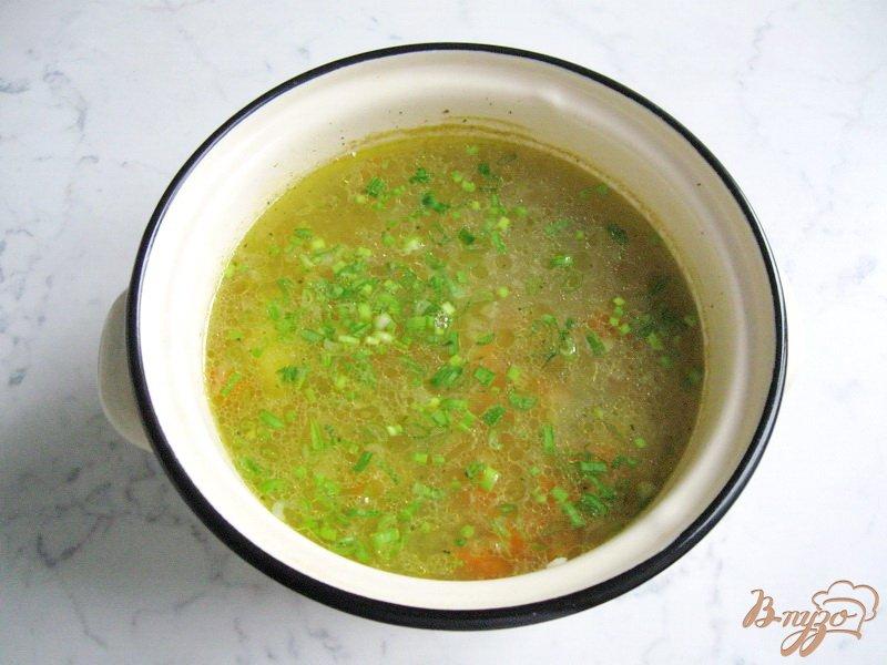 Фото приготовление рецепта: Рассольник с зеленым горошком шаг №7