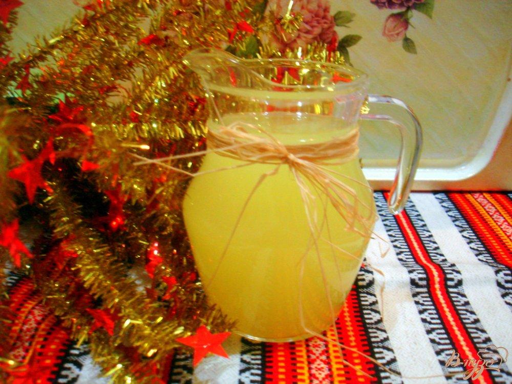 Фото приготовление рецепта: Напиток из апельсинов и лимона шаг №6