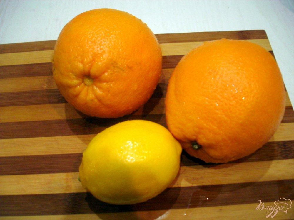 Фото приготовление рецепта: Напиток из апельсинов и лимона шаг №1