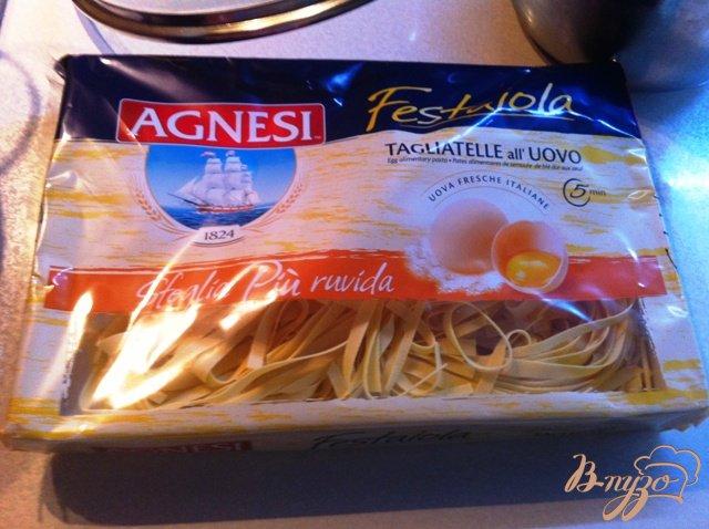 Фото приготовление рецепта: Тагльятелле с мидиями в томатном соусе шаг №6