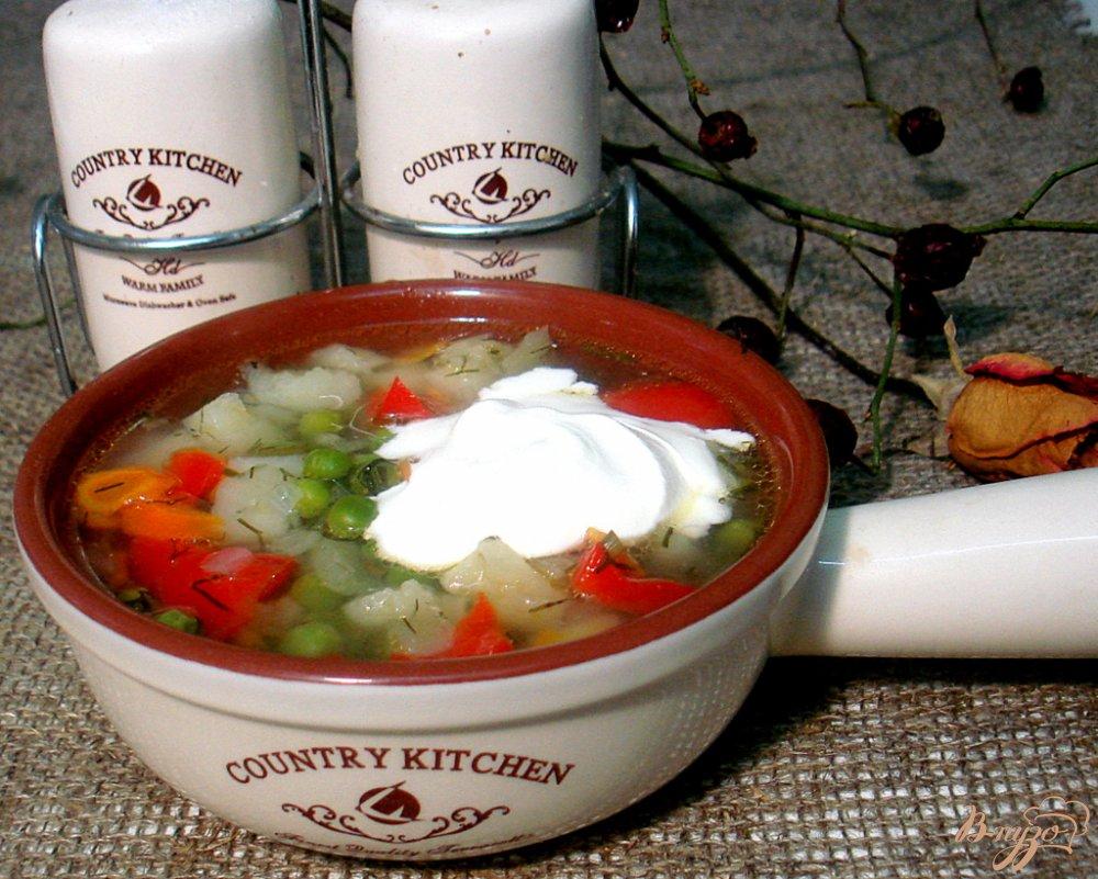Фото приготовление рецепта: Суп с зелёным горошком и перцем шаг №9