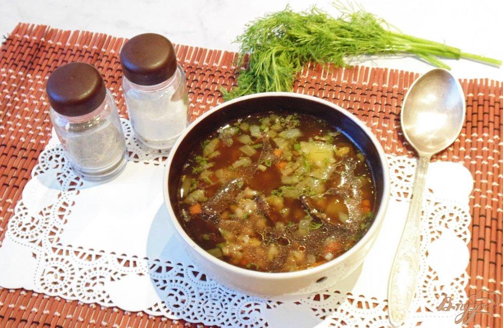 Фото приготовление рецепта: Суп с перловкой и лесными грибами шаг №10
