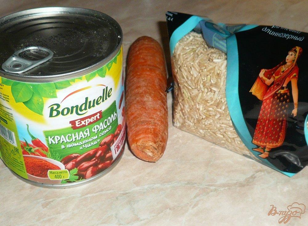 Фото приготовление рецепта: Рисовый томатный суп с фасолью шаг №2