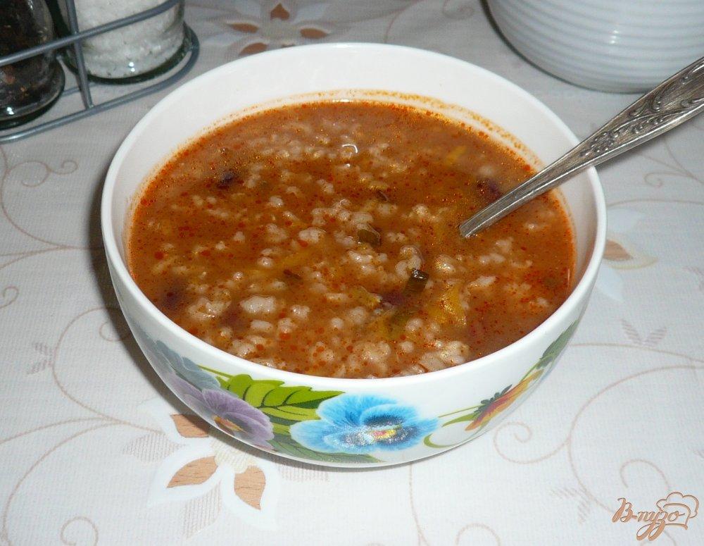 Фото приготовление рецепта: Рисовый томатный суп с фасолью шаг №9