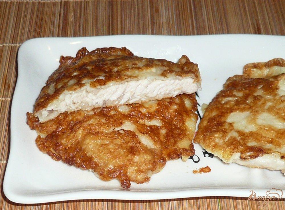 Фото приготовление рецепта: Сочные куриные отбивные в кляре шаг №10