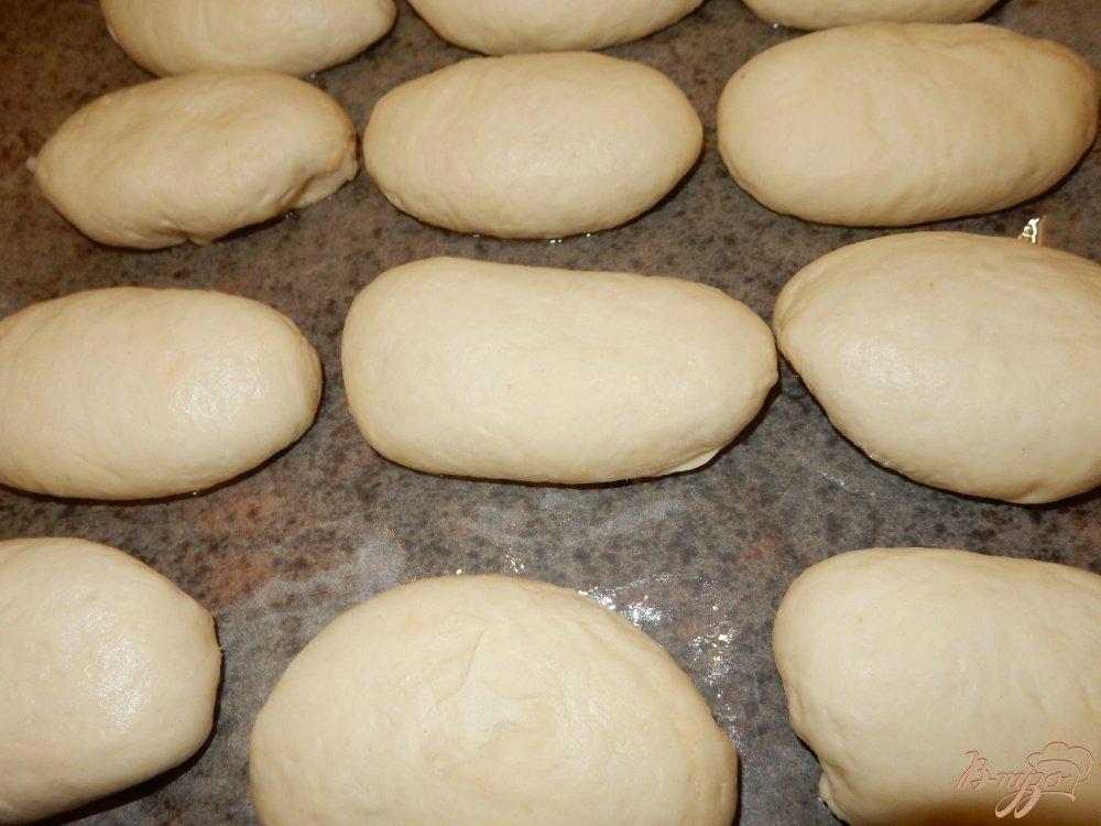 Фото приготовление рецепта: Пирожки с рисом и изюмом шаг №8
