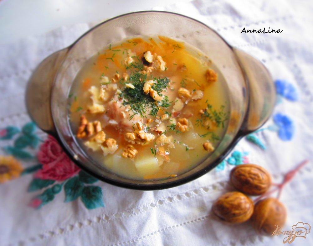Фото приготовление рецепта: Суп с кроликом, яблоком и грецкими орехами шаг №7