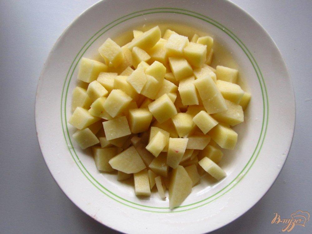 Фото приготовление рецепта: Суп с кроликом, яблоком и грецкими орехами шаг №5