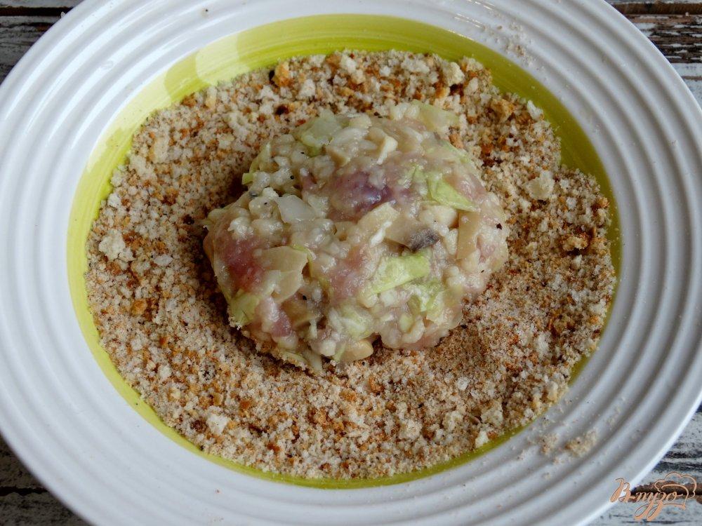 Фото приготовление рецепта: Ленивые голубцы со свининой, кускусом и грибами шаг №7