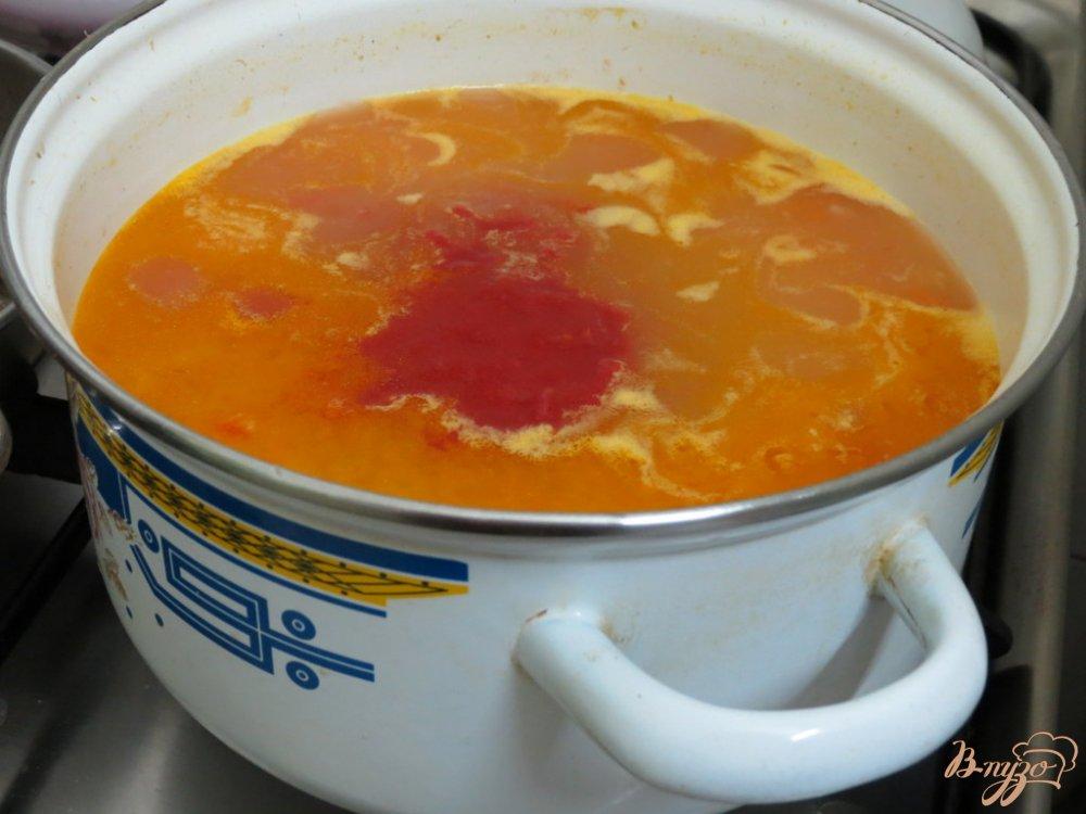 Фото приготовление рецепта: Томатный суп с рисом шаг №7