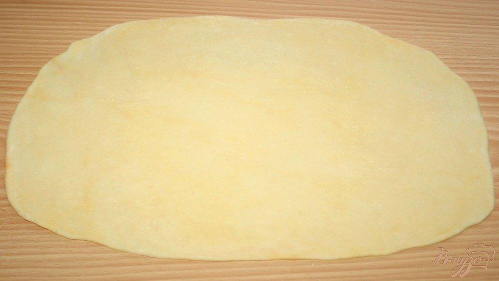 Фото приготовление рецепта: Домашняя паста с нутом и маслинами шаг №7