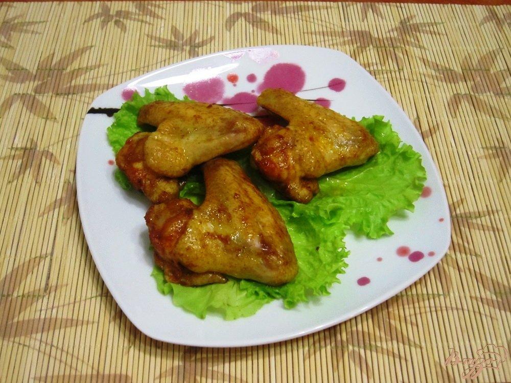 Фото приготовление рецепта: Запеченные куриные крылья шаг №7