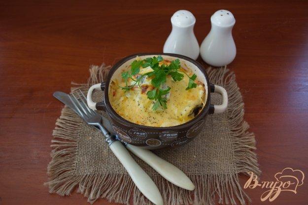 фото рецепта: Минтай под сметаной и сыром в духовке
