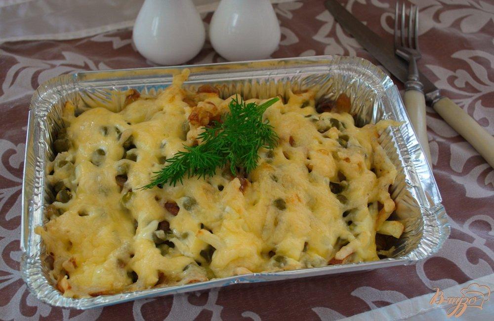 Фото приготовление рецепта: Запеченный минтай в духовке под сыром шаг №7