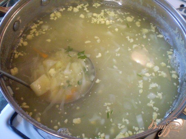 Фото приготовление рецепта: Суп капустный с пшеном и яйцами шаг №9