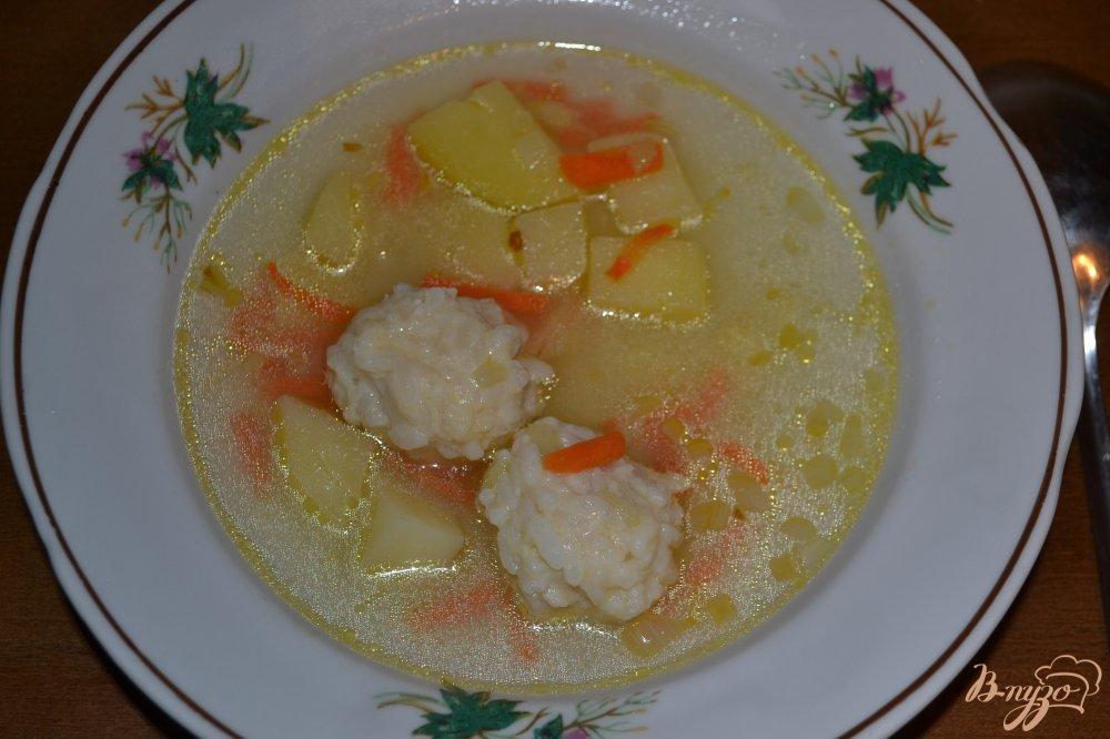Фото приготовление рецепта: Суп с фрикаделями из риса и курицы шаг №12