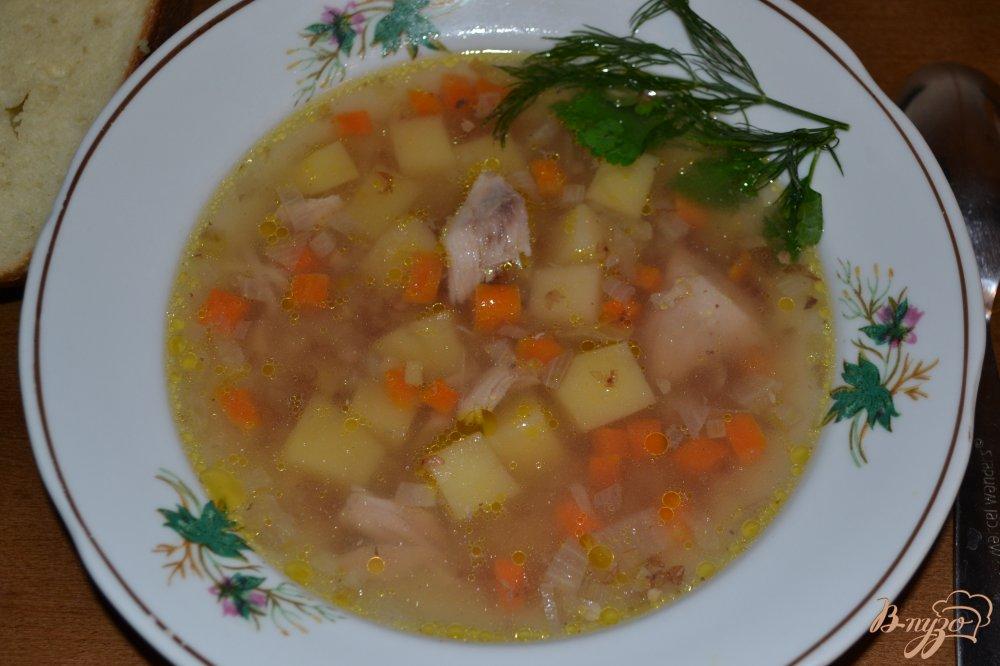 Фото приготовление рецепта: Гречневый суп с голенями в мультиварке шаг №9