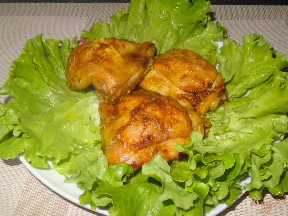 Фото приготовление рецепта: Куриные бедрышки запеченные в духовке шаг №7