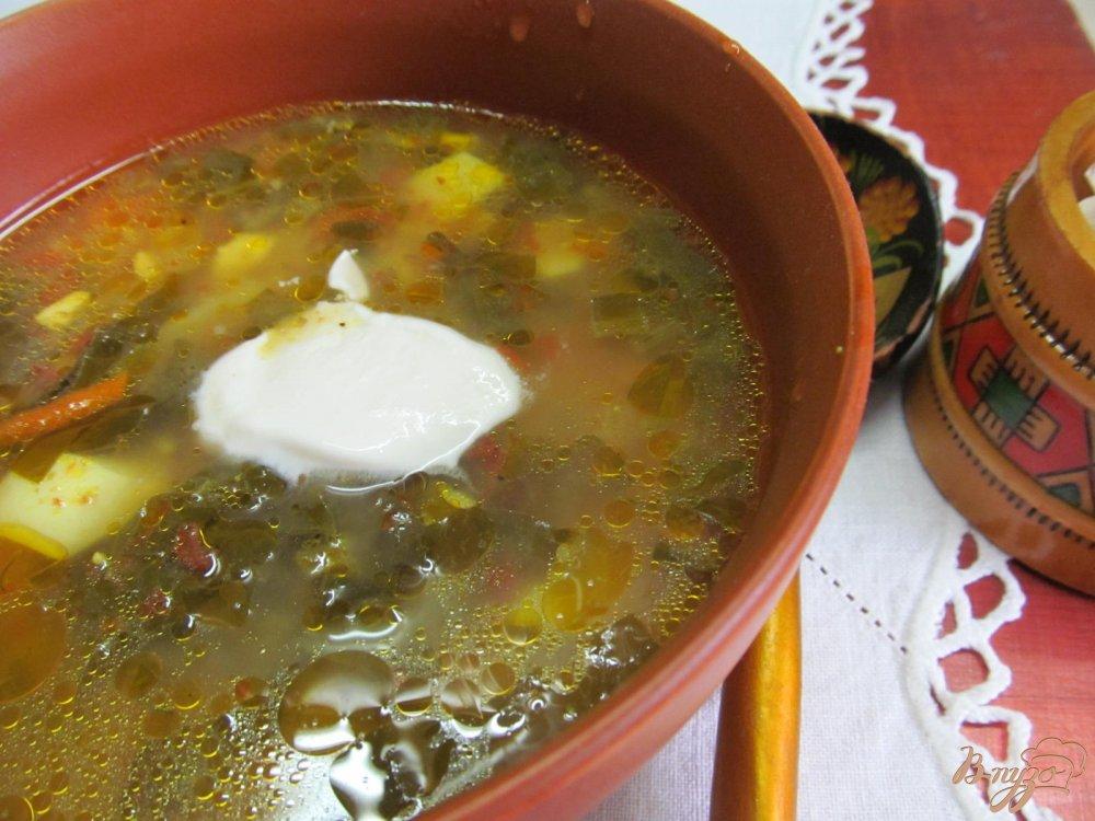 Фото приготовление рецепта: Зеленый борщ с томатом и пшеном шаг №12