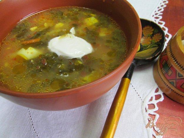 фото рецепта: Зеленый борщ с томатом и пшеном