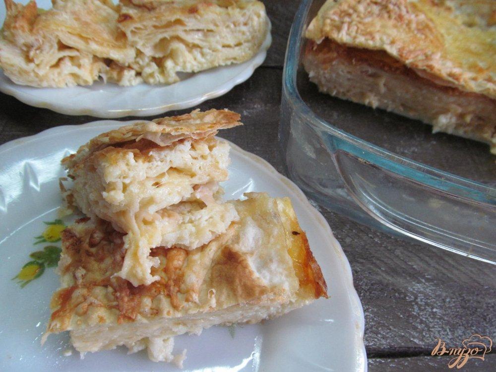 Фото приготовление рецепта: Слоеный сырный пирог в лаваше шаг №8