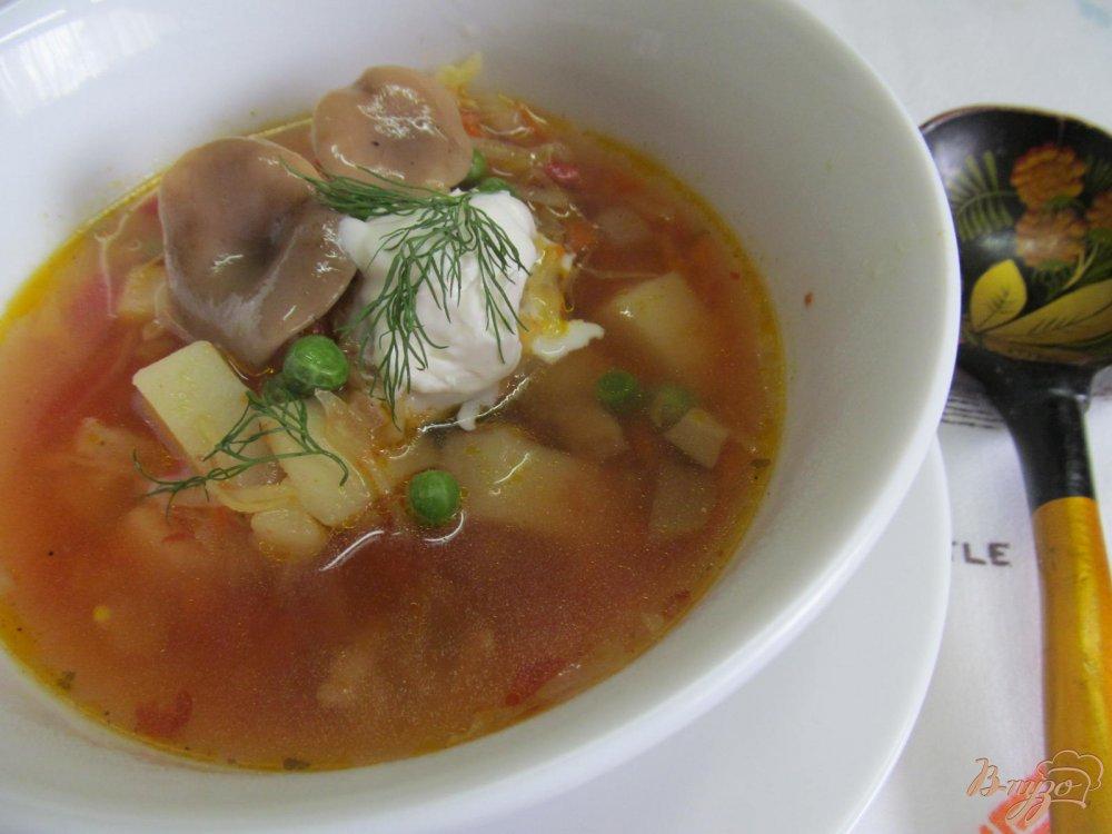Фото приготовление рецепта: Борщ с маринованными грибами горошком и фасолью шаг №12