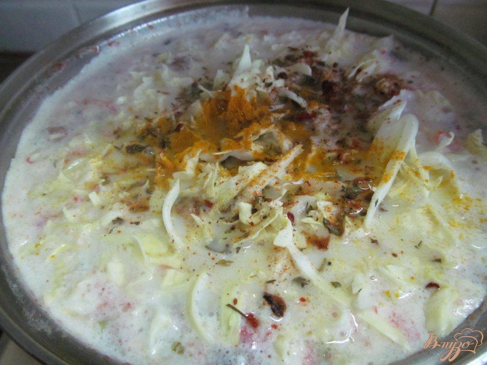 Фото приготовление рецепта: Легкий суп с капустой и грибами шаг №9