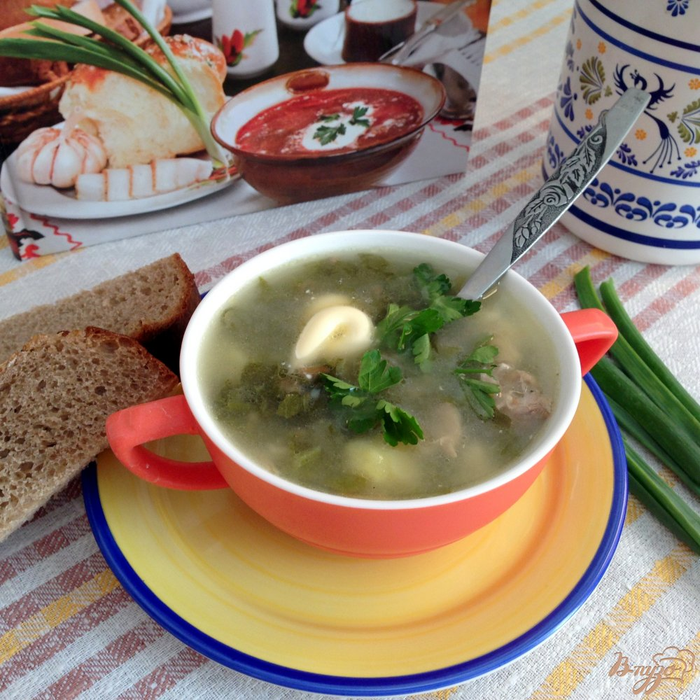 Фото приготовление рецепта: Щавелевый суп с домашней курицей шаг №7