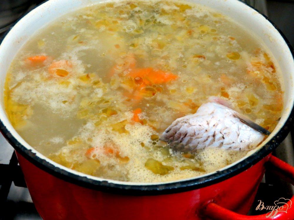 Фото приготовление рецепта: Рыбная похлёбка с пшеном. шаг №9