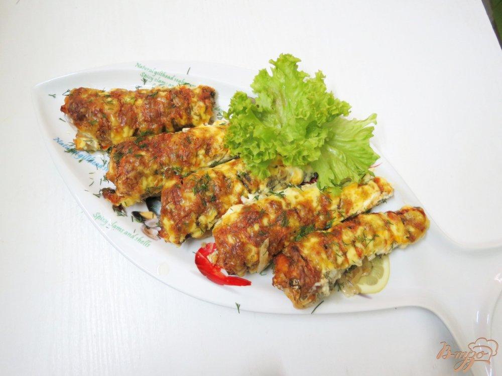 Фото приготовление рецепта: Нототения запеченная с чесноком и укропом. шаг №8