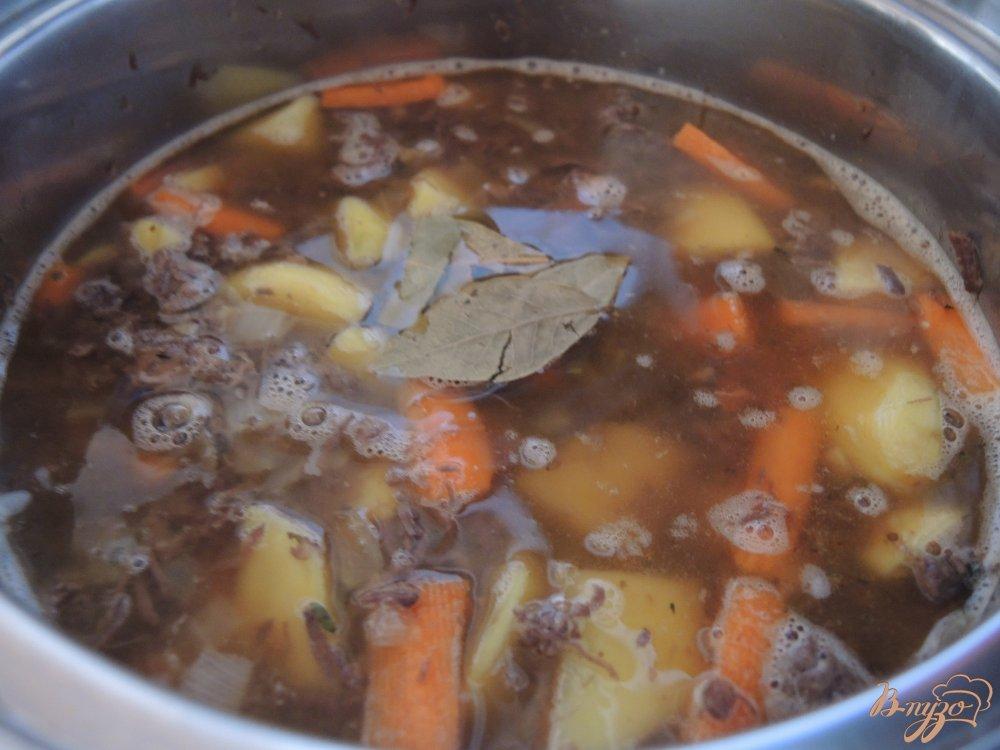 Фото приготовление рецепта: Тушеная оленина с овощами шаг №8