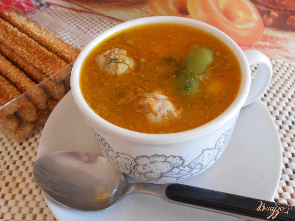 Фото приготовление рецепта: Суп со стручковой фасолью и мясными шариками шаг №7