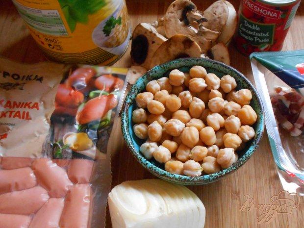 Рецепт Кислая капуста тушеная с сосисками и грибами