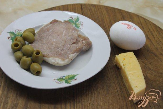 Рецепт Свиная отбивная с оливками под сыром