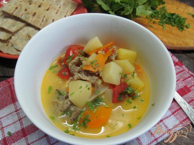 фото рецепта: Суп на бульоне из баранины с помидором и пшеном