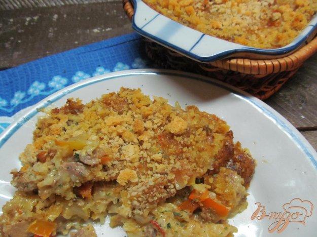 фото рецепта: Запеканка со свининой овощами и вермишелью под грибным соусом