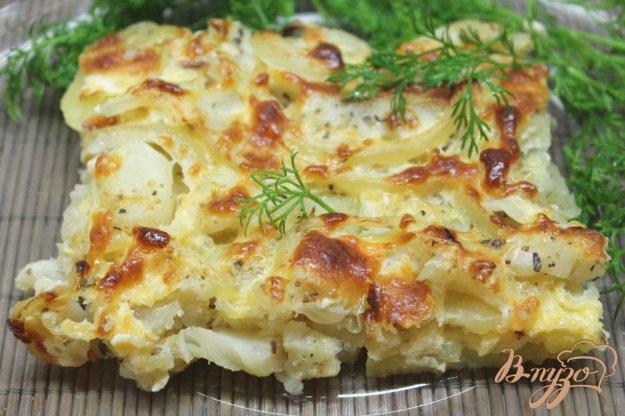 фото рецепта: Минтай запеченый с картофелем и сыром