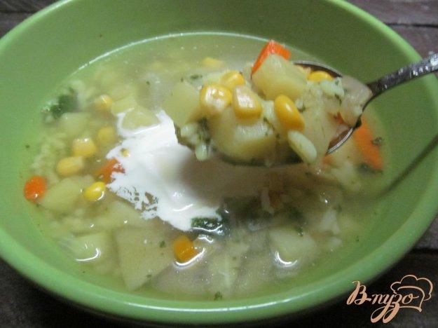 фото рецепта: Суп с тыквой рисом и кукурузой