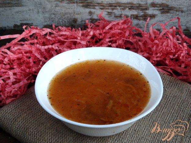 фото рецепта: Суп с квашеной капустой, опятами и кус-кусом