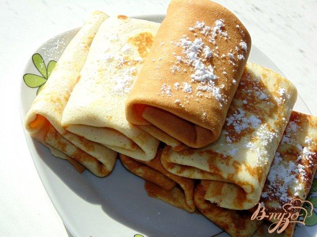 фото рецепта: Блины с сахарной пудрой и сливочным маслом