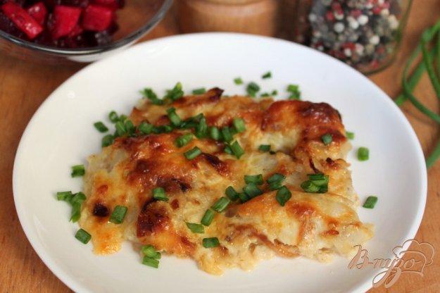 фото рецепта: Минтай с луком и сыром запеченный в духовке