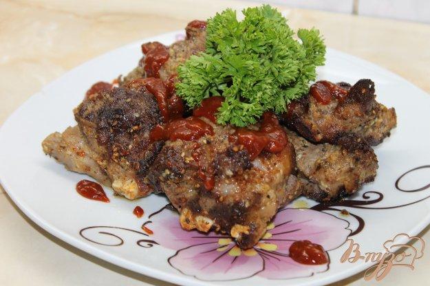 фото рецепта: Тушенные свиные ребра с горчицей и итальянскими травами