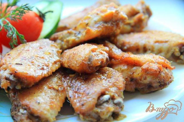 фото рецепта: Куриные крылышки в маринаде с аджикой