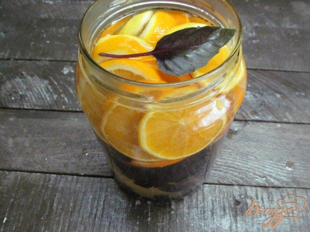 фото рецепта: Напиток из апельсина с лимоном и базиликом