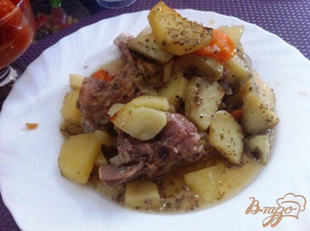 фото рецепта: Свиные ребрышки запеченные с картофелем