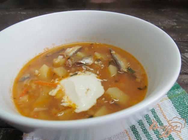 фото рецепта: Суп с килькой в томате рисом и пшеном