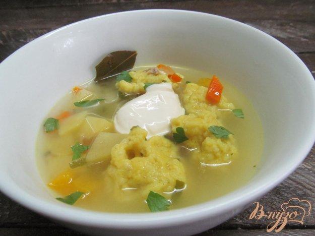 фото рецепта: Суп с клецками из пшена и чеснока