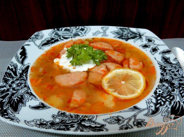фото рецепта: Суп с колбасой и солёными огурцами